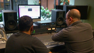"""Christian behind the console in Musitechnic""""s Green studio"""